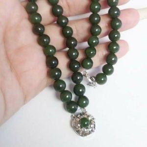 Jade bead and sterling silver dbl strand bracelet